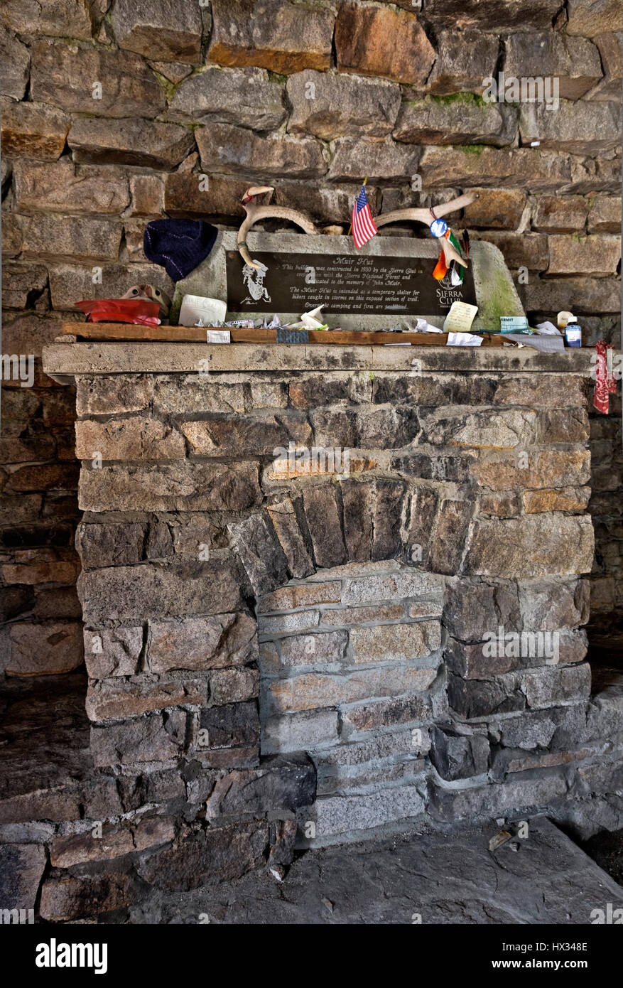 CA03125-00...CALIFORNIA - Interior of the stone shelter, mementos left on the mantle, at the summit of Muir Pass - Stock Image