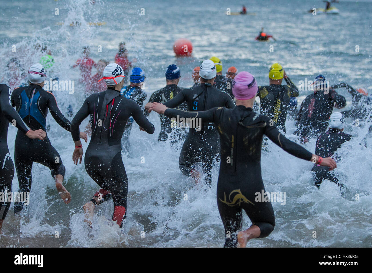 People take part in Ironman Wales, 2015, Tenby, Pembrokeshire, Wales, UK - Stock Image