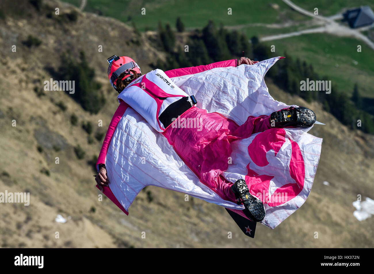 Base jumper flying with wingsuit in the air, jump from Mount Pilatus, Lucerne, Switzerland - Stock Image