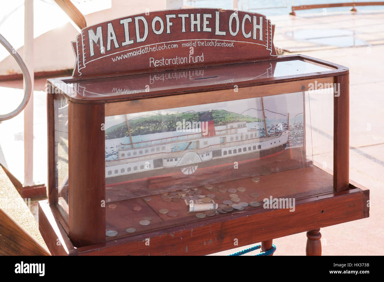 Maid of the Loch Restoration Fund collection donation box including old style pound coins, Balloch, Scotland, UK - Stock Image
