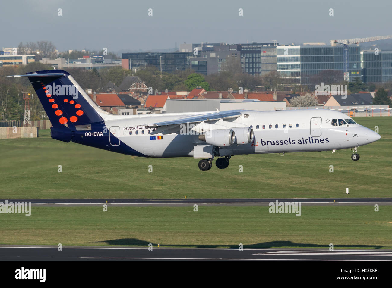 Brussels Airlines BAe Avro RJ100 landing on runway 01 at Brussels Airport. - Stock Image