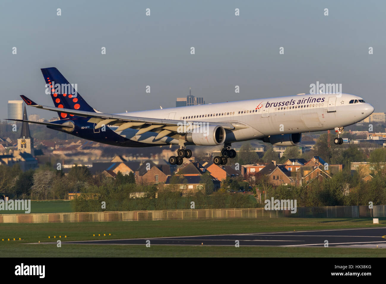 Brussels Airlines Airbus A333 landing on runway 01 at Brussels Airport. - Stock Image