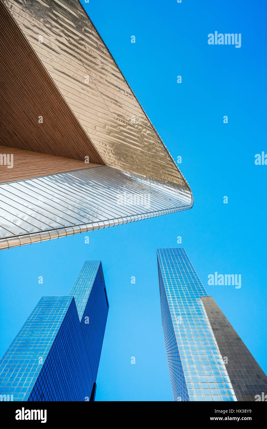 The roof of the Rotterdam Centraal railway station and Gebouw Delftse Poort (twin-tower skyscraper complex), Rotterdam, - Stock Image