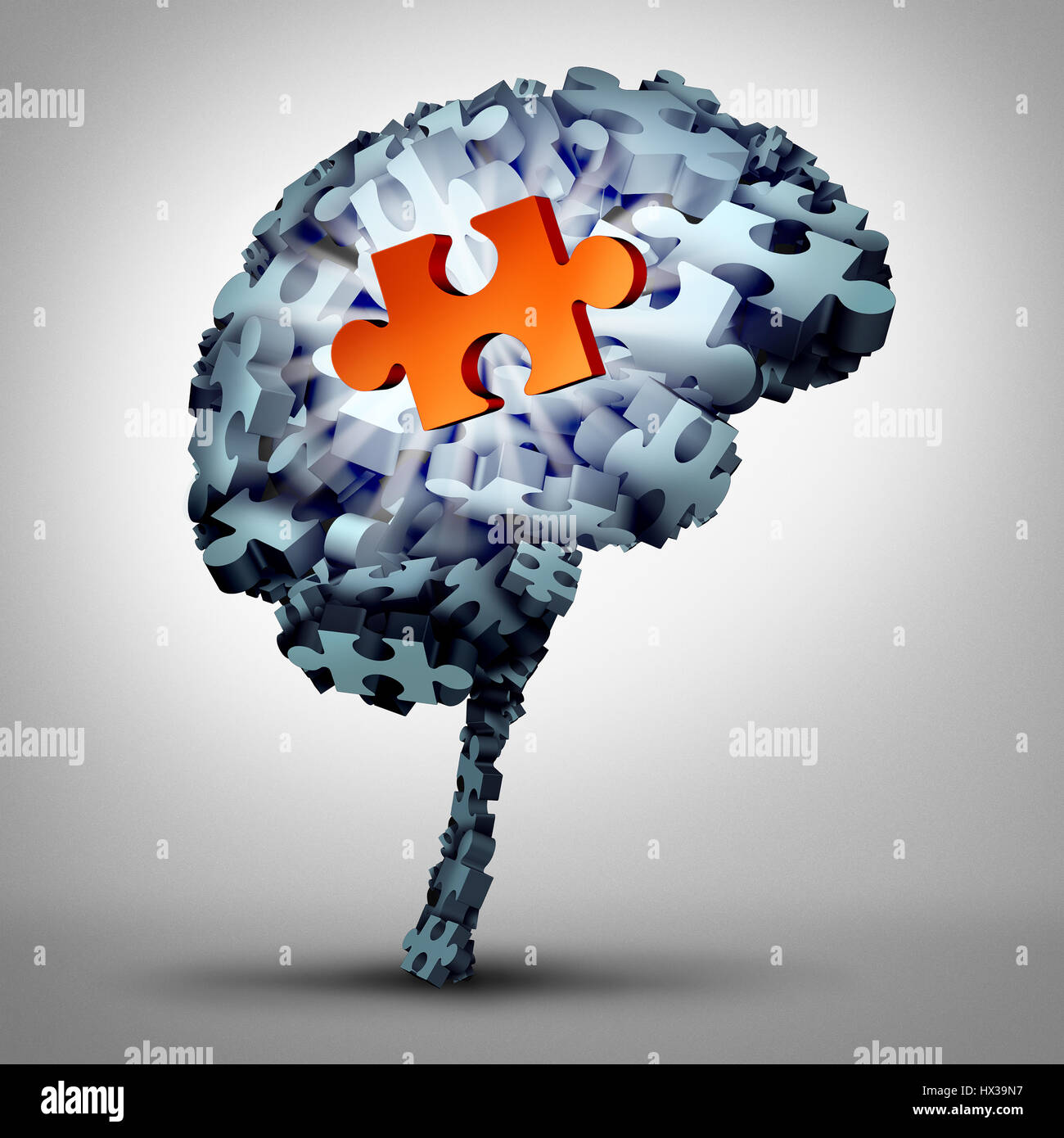 Brain puzzle solution as a human mind made of jigsaw pieces with one object as a glowing red symbol of inspiration - Stock Image