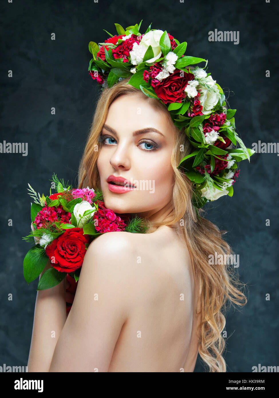 Portrait of a beautiful blonde girl with a composition of flowers portrait of a beautiful blonde girl with a composition of flowers izmirmasajfo