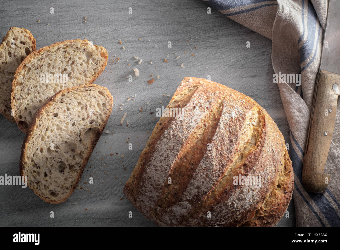 Sliced Artisan loaf of bread - from above - Stock Image