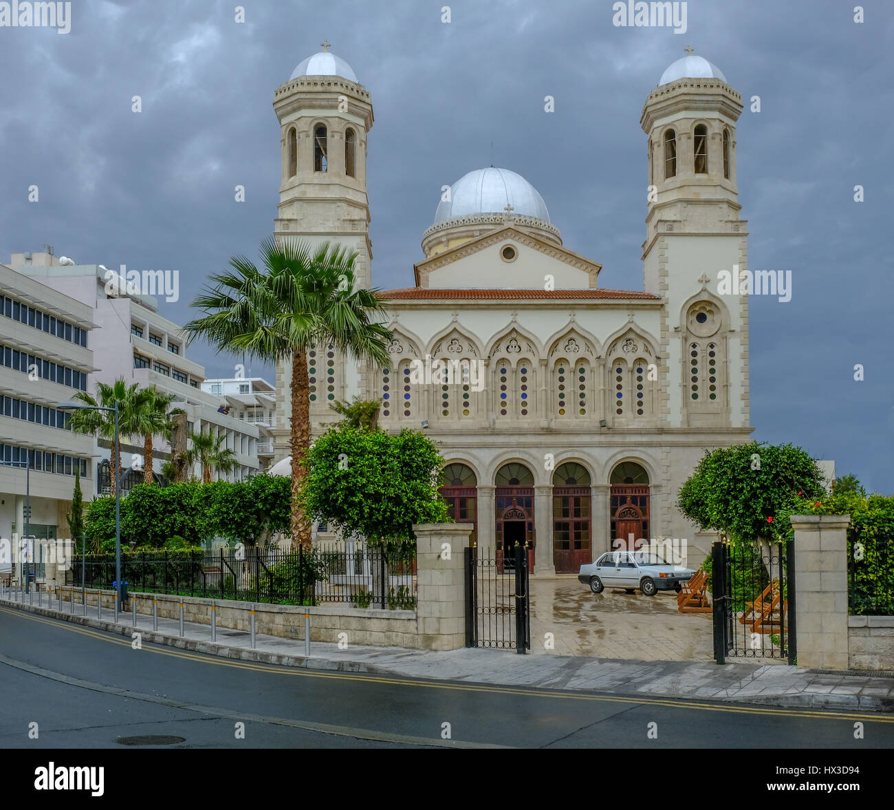 Beautiful church in the old town of Lemesos, Limassol, Cyprus.  A shot taken on a storymy afternoon in Spring. Stock Photo