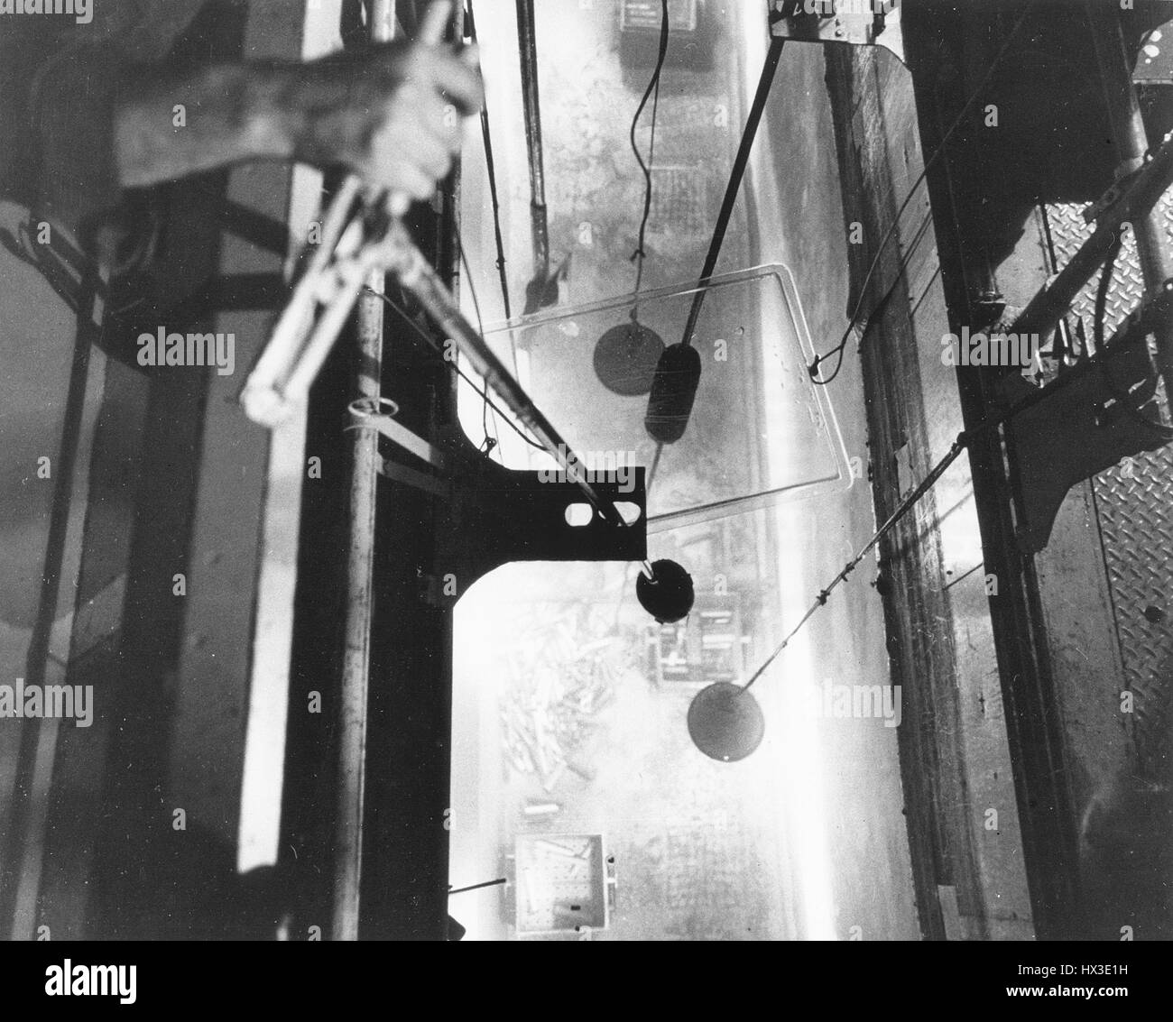 An operator at Hanford's C reactor loads fuel elements into transfer boxes under 20 feet of water after they - Stock Image