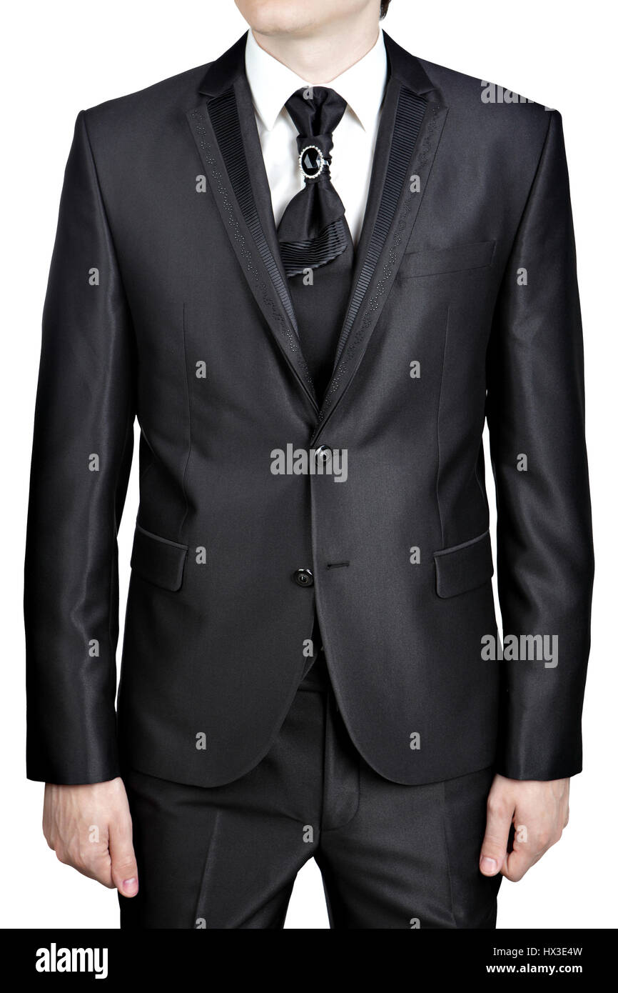Dark gray for man evening suit with a tie, tie knot decorated with a big brooch pin. Stock Photo