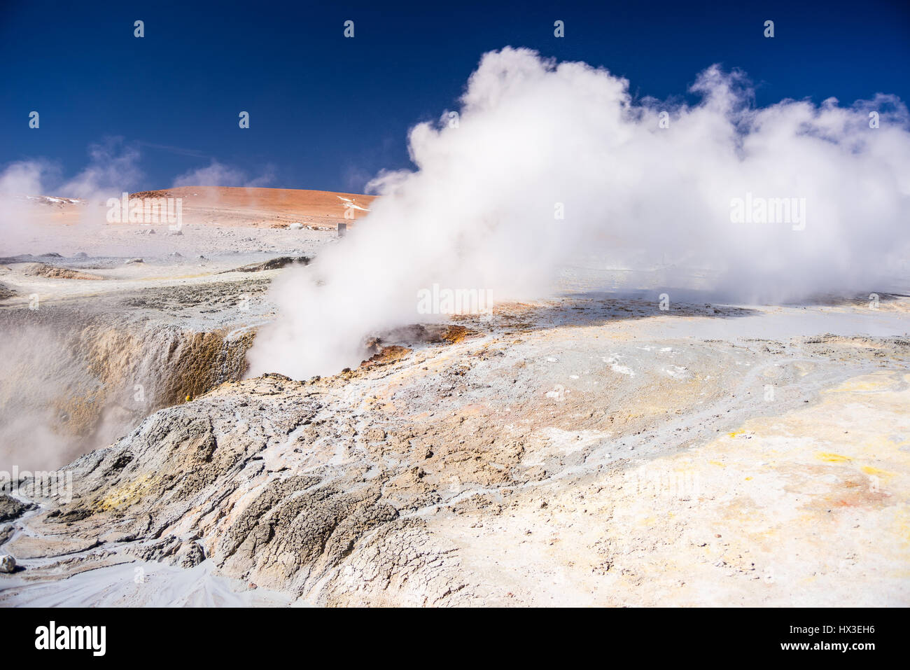 Steaming hot water ponds and mud pots in geothermal region of the Andean Highlands of Bolivia. Roadtrip to the famous - Stock Image