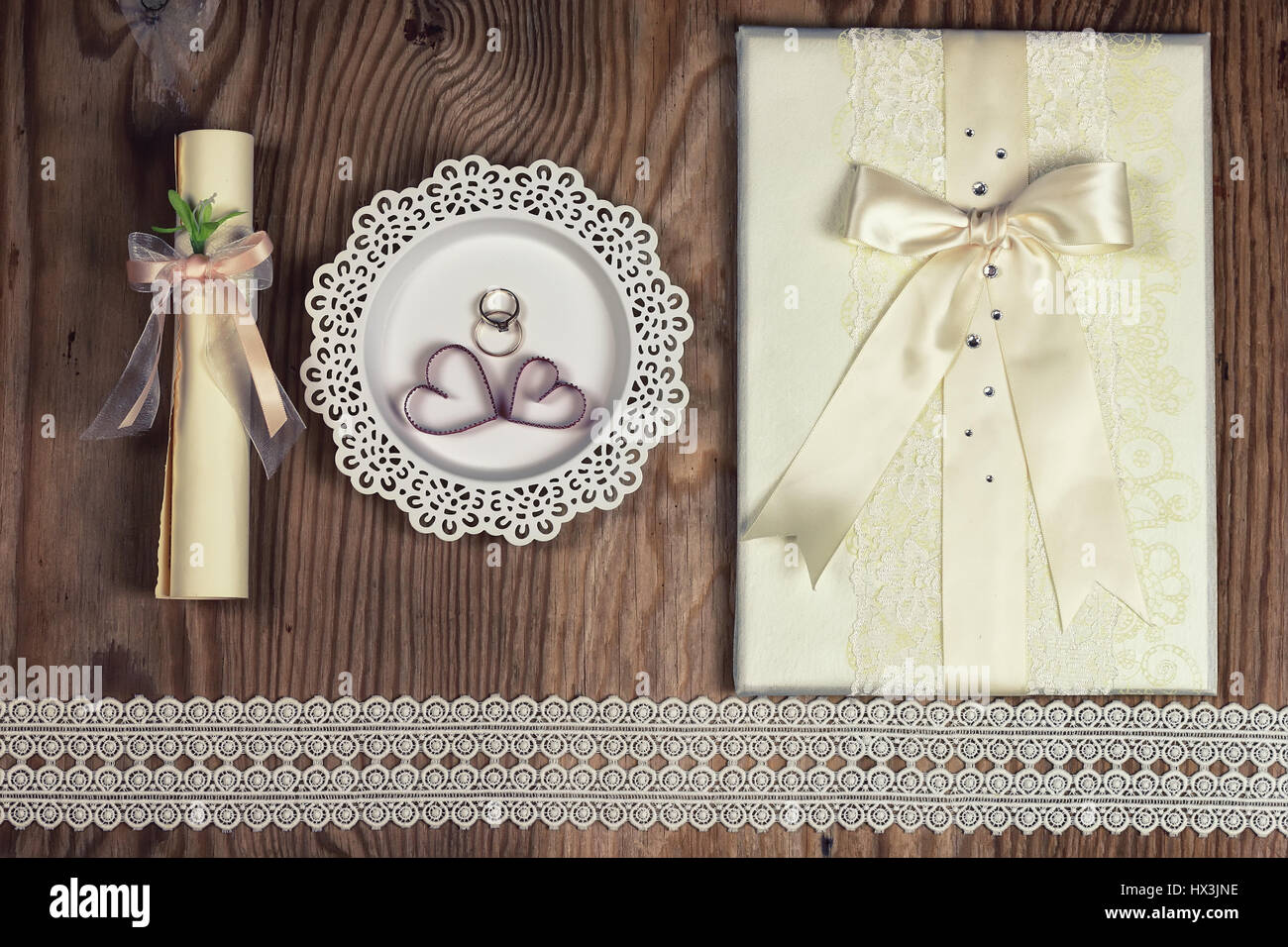 wedding ring invitation wood background - Stock Image