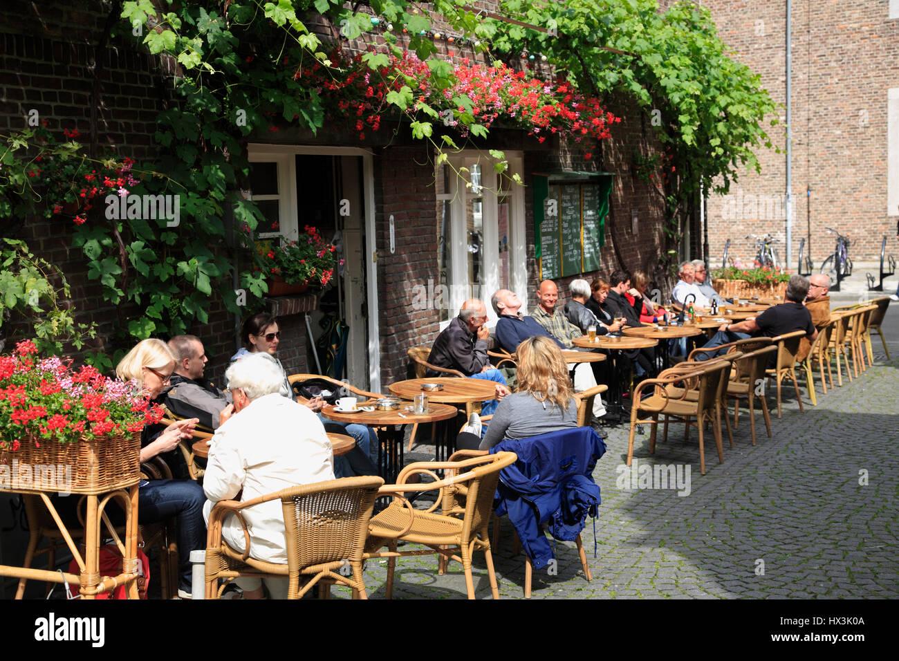 Cafe and bar in Maastricht, Limburg, Netherlands, Europeflowers - Stock Image