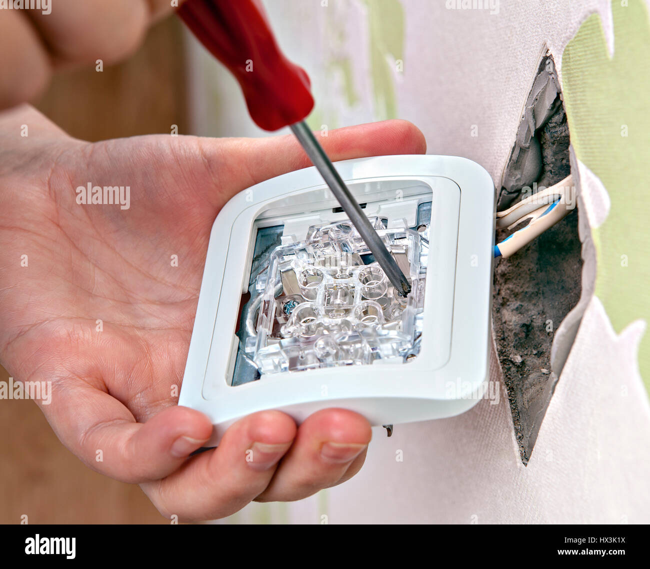 Change light switch, connect the wires from house wiring Stock Photo ...