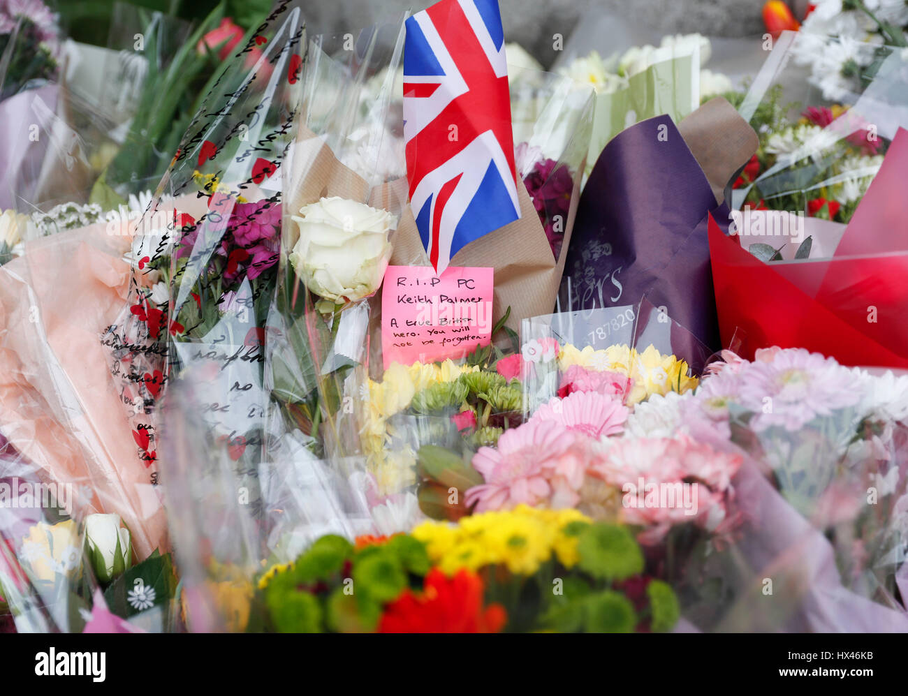 London, UK. 24th March, 2017. Westminster terror attack in central London.  Floral tributes to the victims are seen outside the Houses of Parliament, two days after the March 22 Westminster terror attack in central London, Britain on March 24, 2017. Credit: Han Yan/Xinhua/Alamy Live News Stock Photo