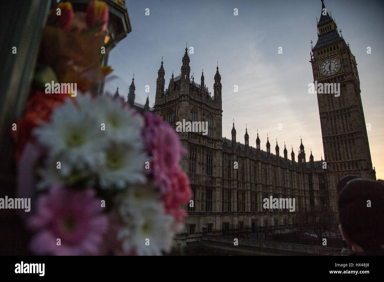 London, UK. 24th Mar, 2017. floral tributes on Westmister bridge folowing Wednesday's attack on Westminster. - Stock Image