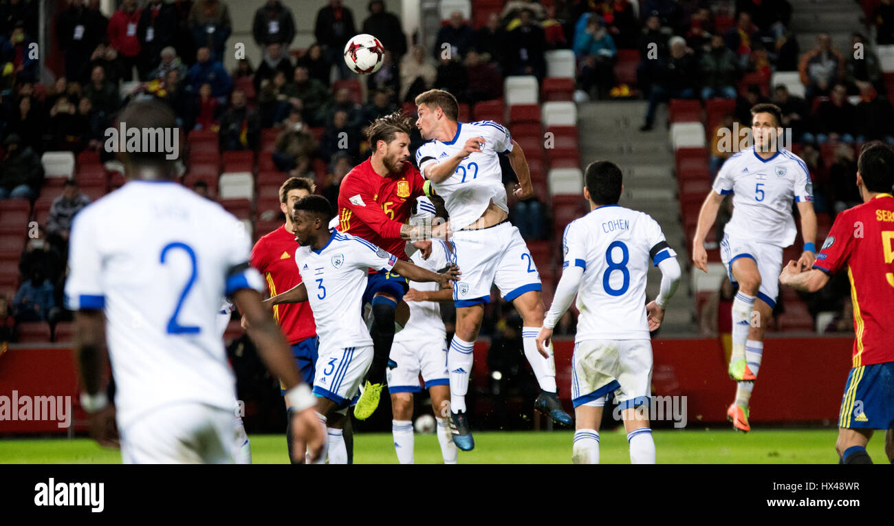 Gijon, Spain. 24th March, 2017. Sergio Ramos (Spain) and David Keltjens (Israel) jump for the possession of the - Stock Image