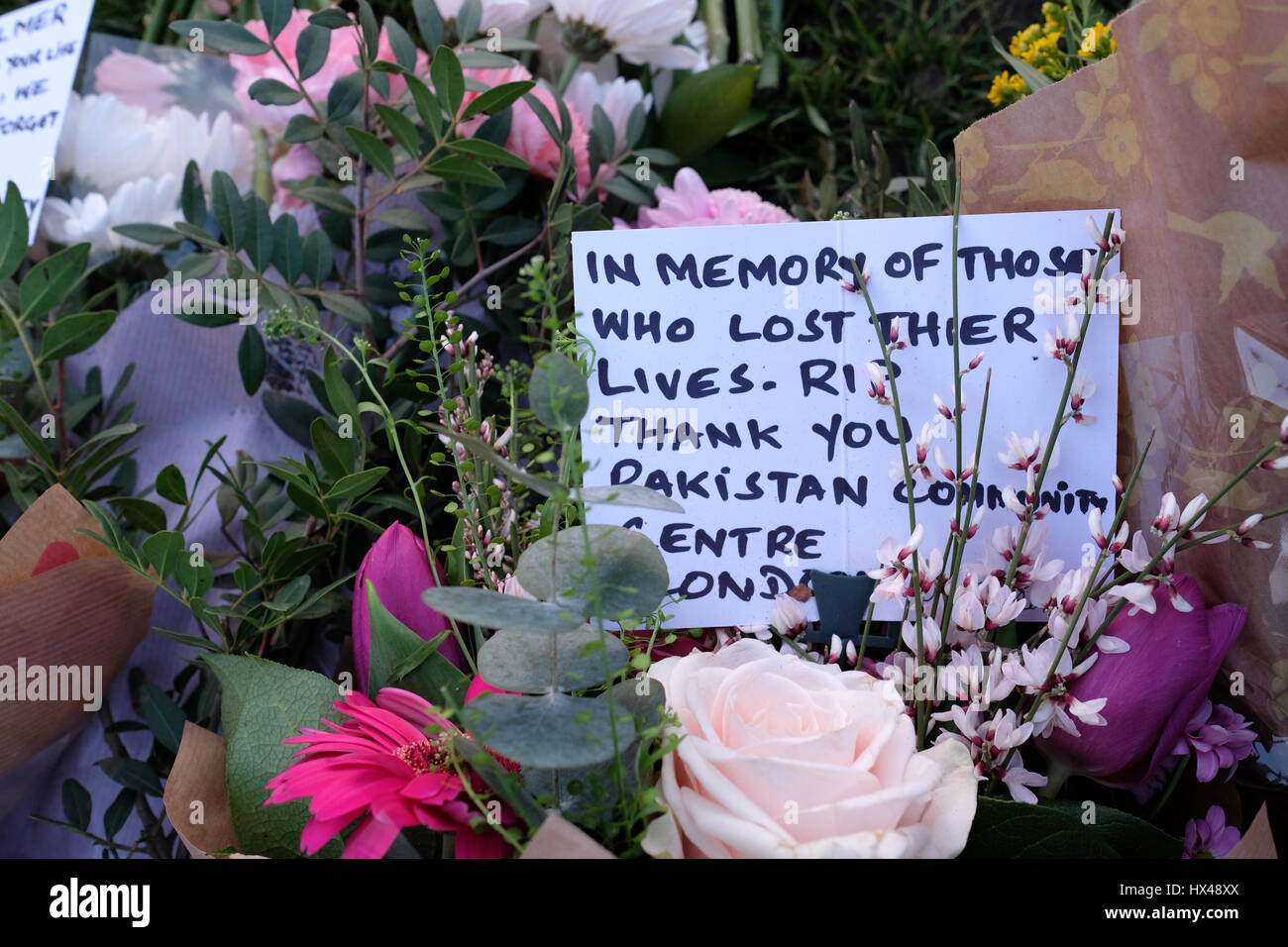London, UK. 24th March 2017. Floral tributes and messages to the victims of Westminster terror attack, Westminster, - Stock Image