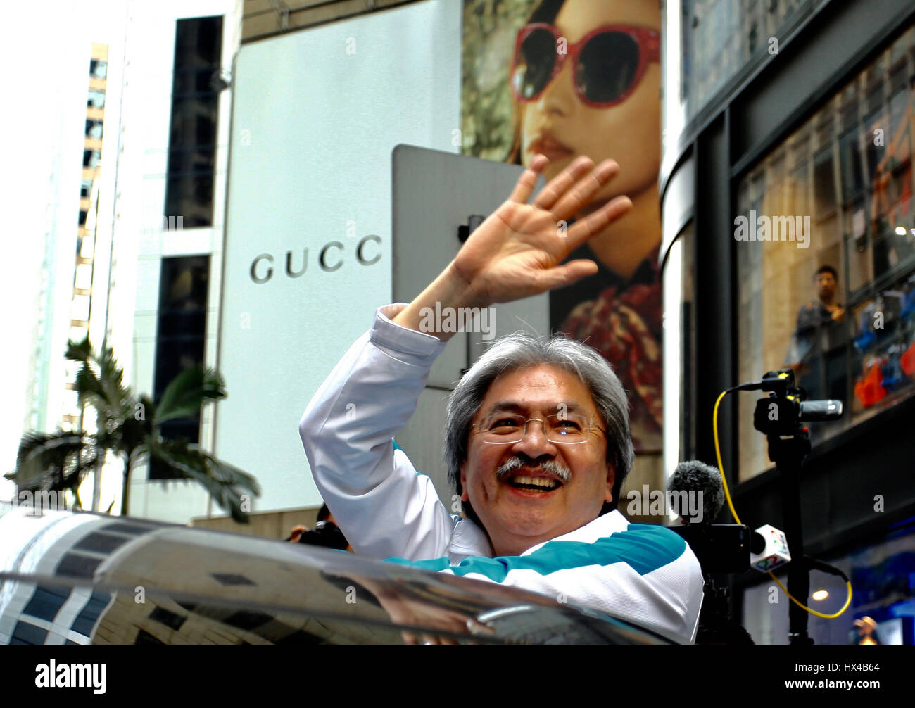 Former HKSAR Financial Secretary John Tsang wave to his supporters at the commercial hub Central with high spirit - Stock Image