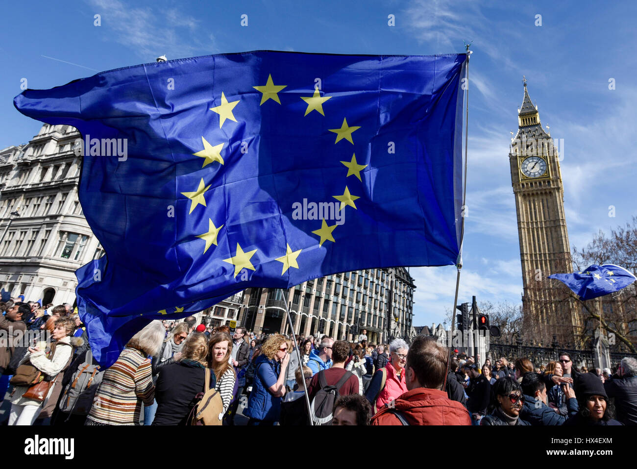 London, UK.  25 March 2017. European Union flags are held aloft as aAnti-Brexit demonstrators take part in a march - Stock Image