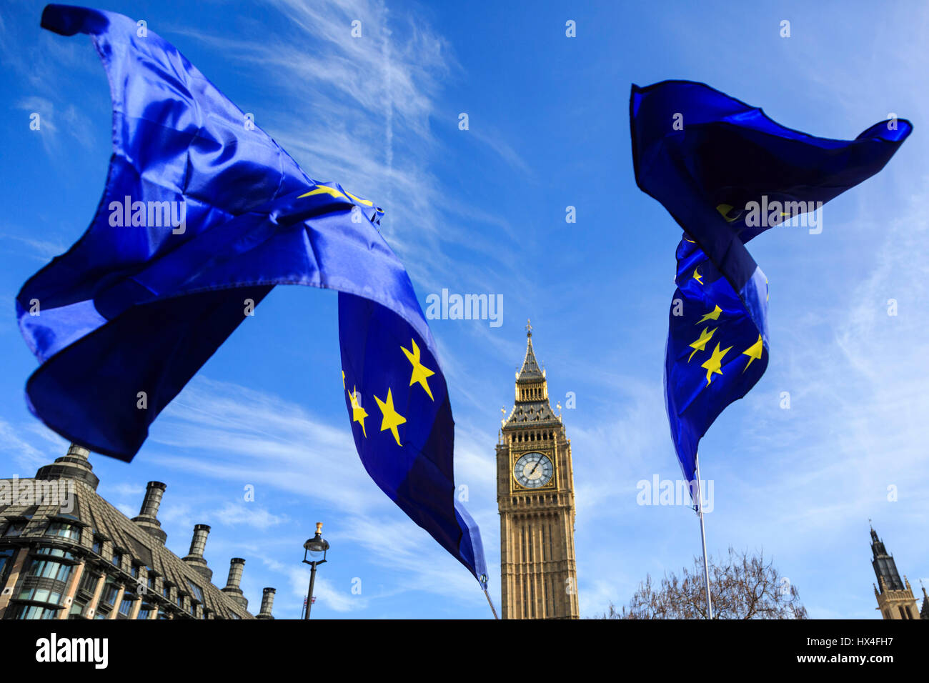 London, UK. 25 March 2017. After the Unite for Europe March, European Union flags fly in front of Big Ben. © - Stock Image