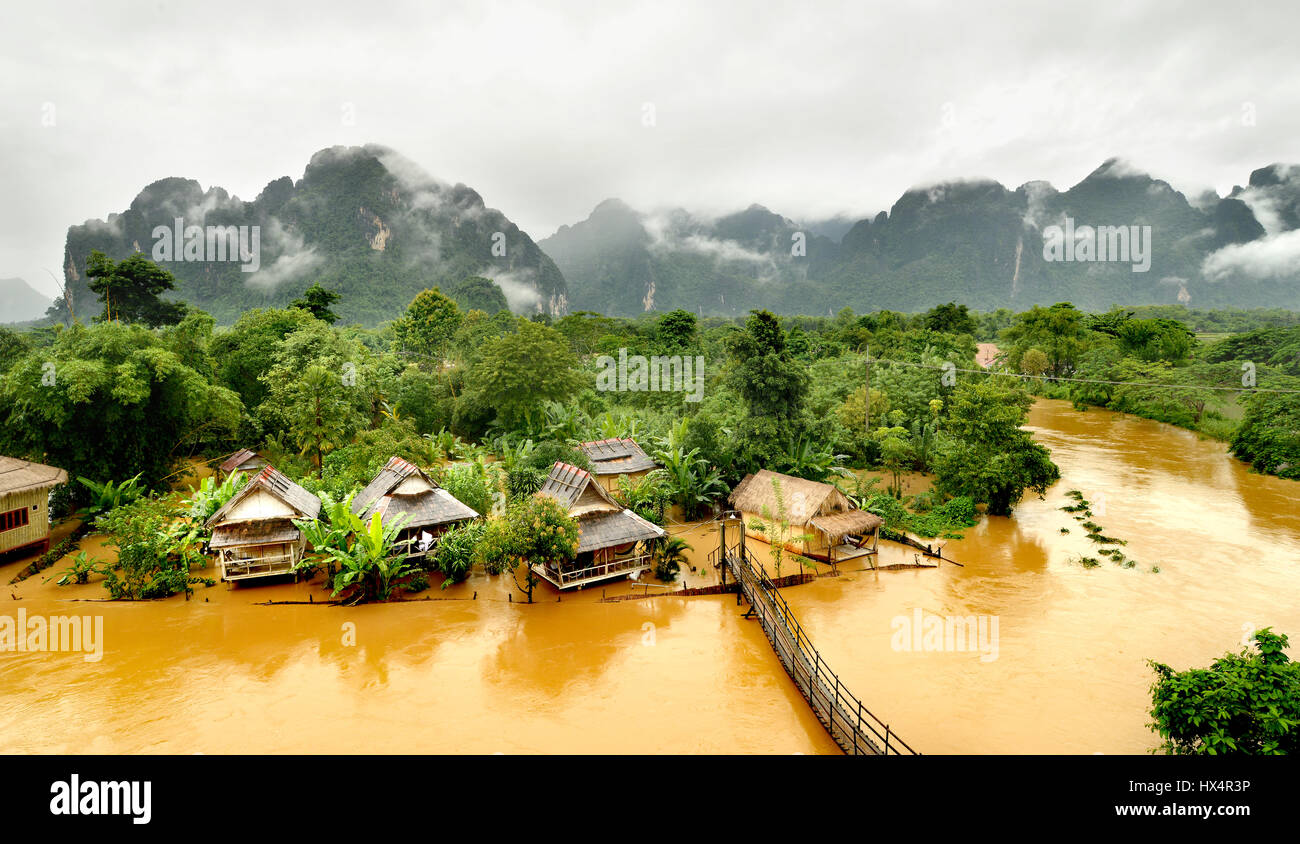 floating river in vangvieng lao after raining day at the morning time with the mist on the hill - Stock Image