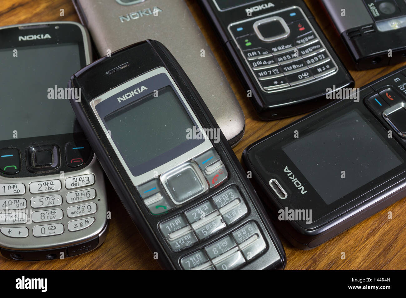 Bangkok, Thailand - March 24, 2017 : Nokia mobile phones on wooden background. - Stock Image