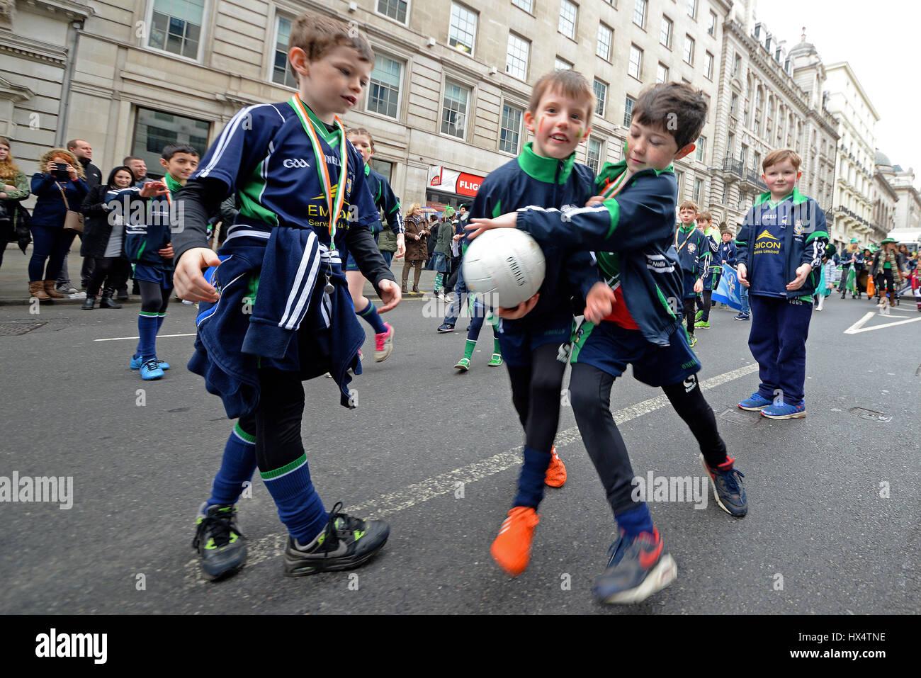 North London Shamrocks Gaelic Football Club boys playing during the 2017 London St. Patrick's Day Parade Stock Photo