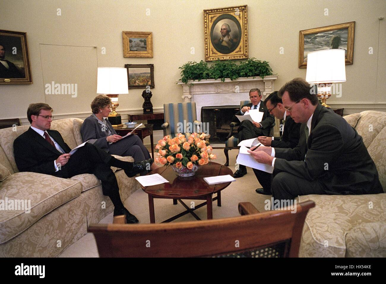 george bush oval office. In The Oval Office Of White House, President George W Bush Sits With Presidential Counselor Karen Hughes And Speechwriters John McConnell, Mike Gerson,