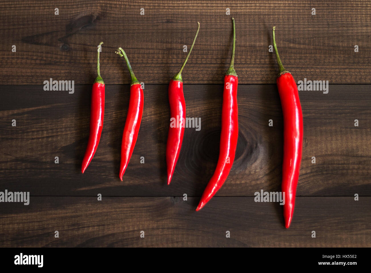 cayenne chilli peppers on wooden background Stock Photo