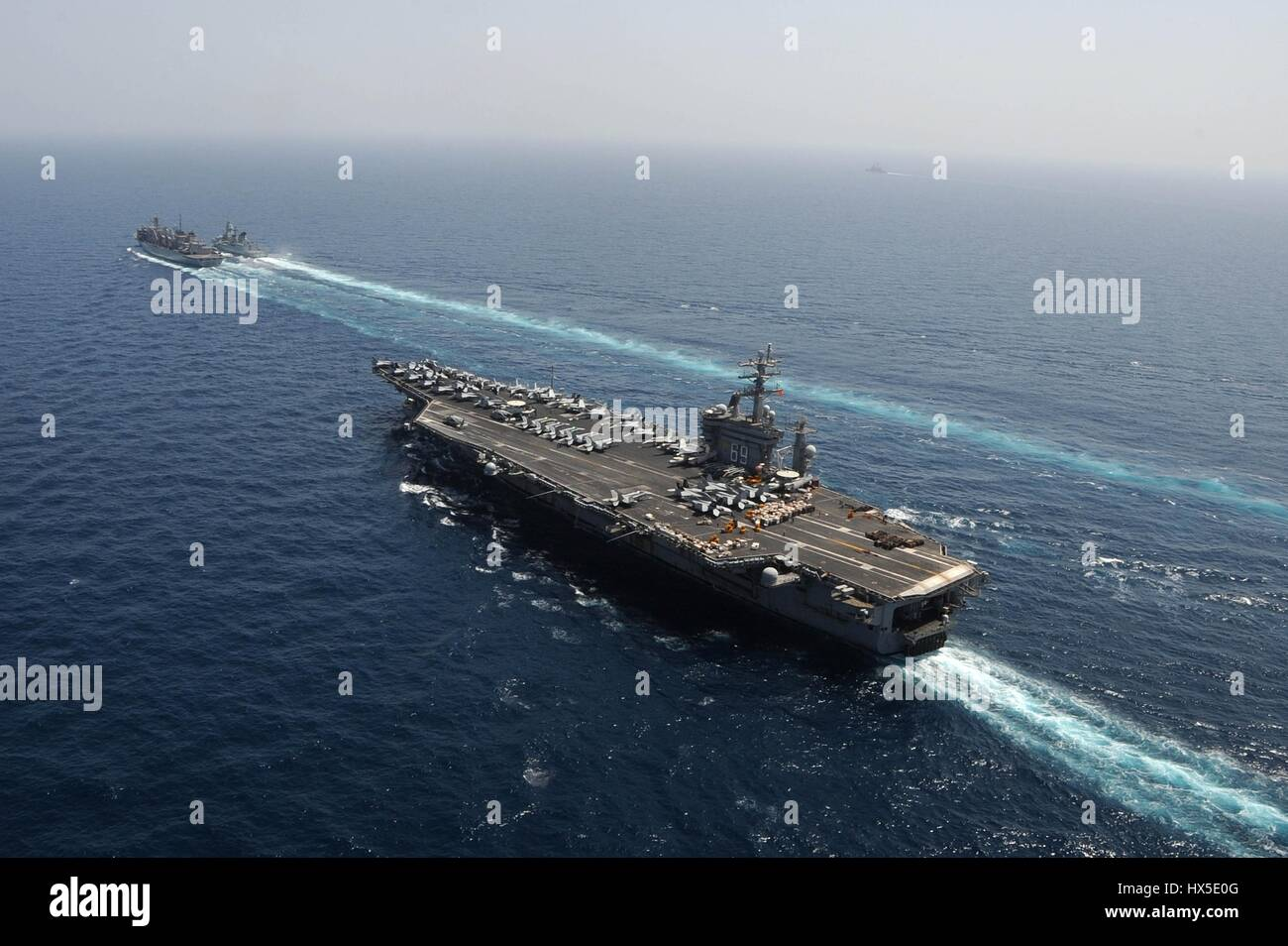 Aircraft carrier USS Dwight D. Eisenhower (CVN 69), Military Sealift Command fast combat support ship USNS Bridge - Stock Image