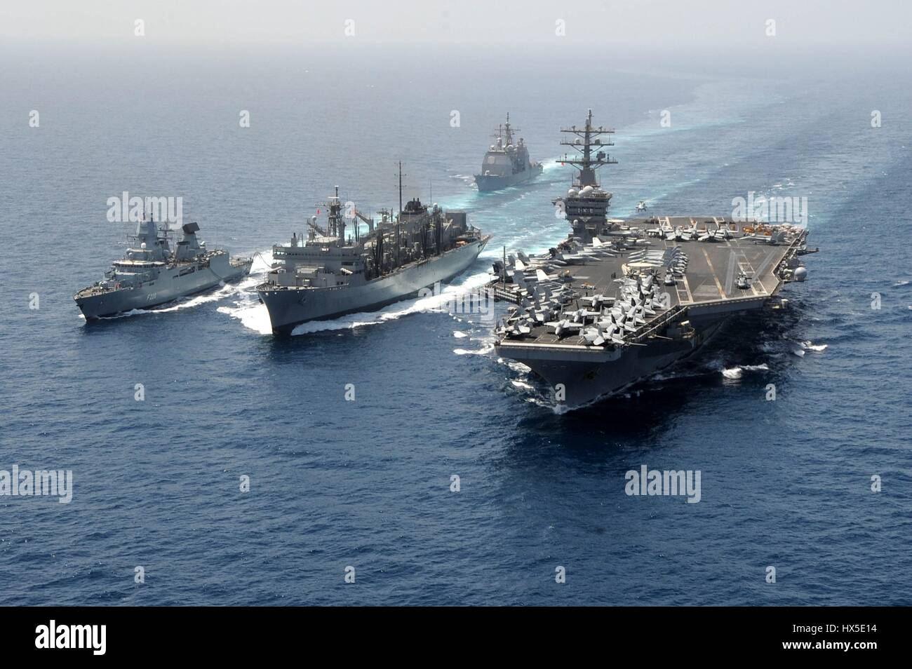 Guided-missile cruiser USS Hue City (CG 66), the German navy frigate FGS Hamburd (F220), the aircraft carrier USS - Stock Image