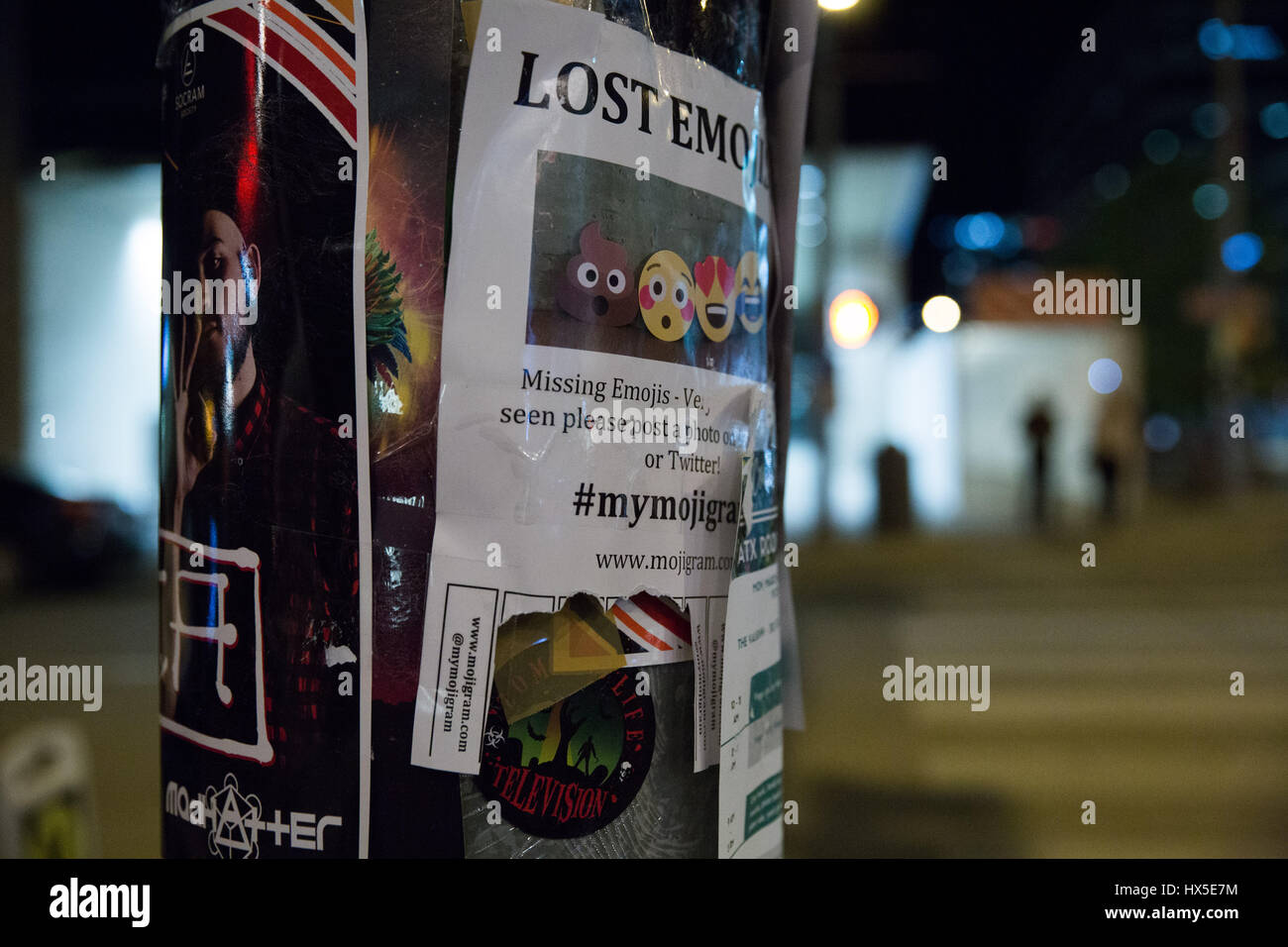 Lost Emoji sign flyposted on lamp post in downtown Austin, Texas. - Stock Image