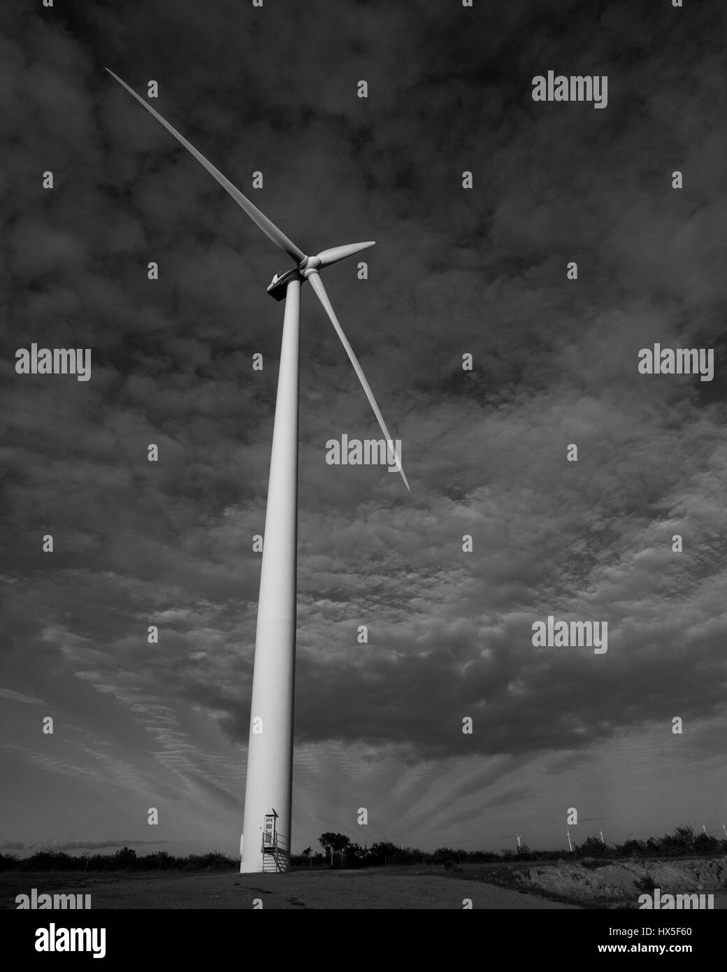 Wind Turbine during cloudy day - Stock Image