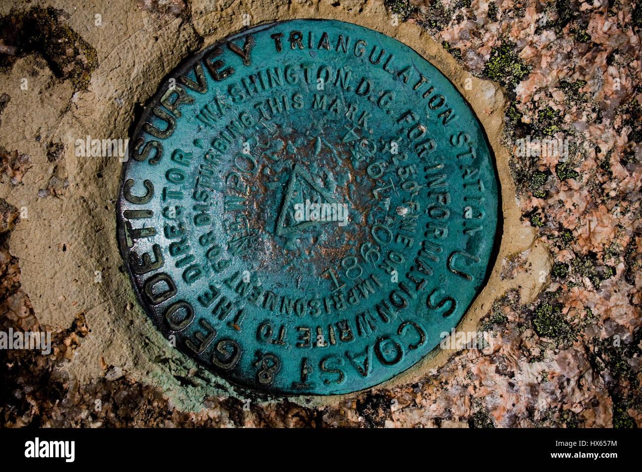 A geodetic survey marker at Acadia National Park near Bar Harbor, Maine. - Stock Image