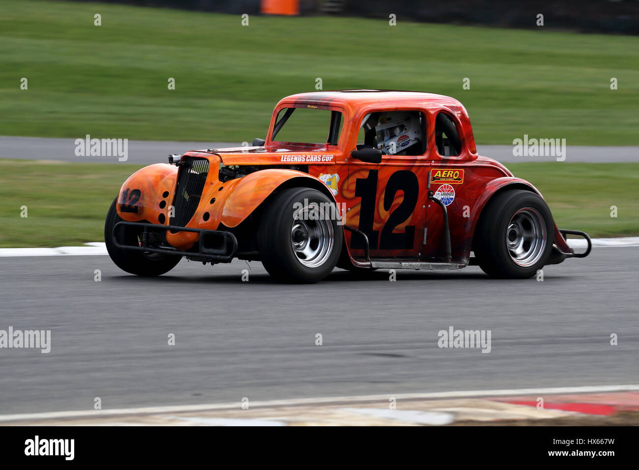 Claude Watteyne driving his Legends 34 Ford Coupe around clearways corner at Brands Hatch motor racing circuit in - Stock Image