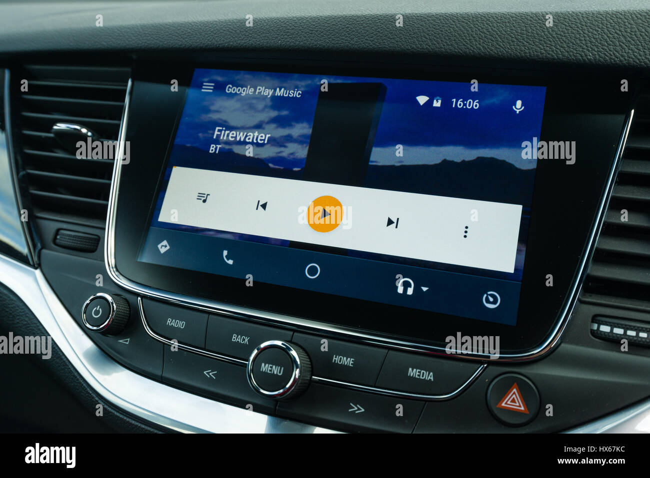 Android Auto Car Vehicle Navigation Interface Showing Google Play Music Interface - Stock Image