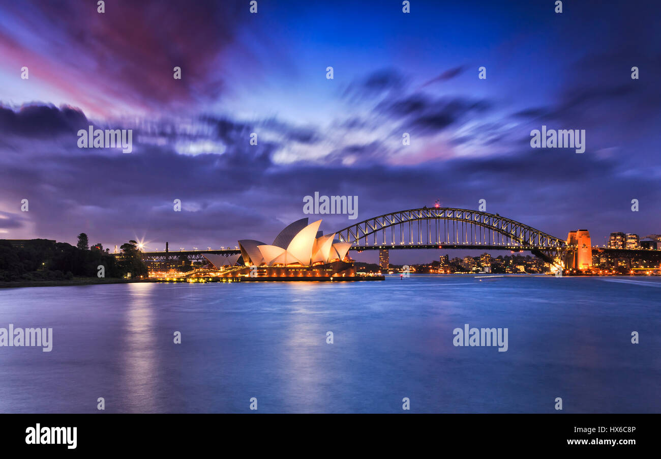 Sydney, Australia - 19 March 2017: World famous Australian landmarks Sydney Opera house and Harbour bridge across - Stock Image