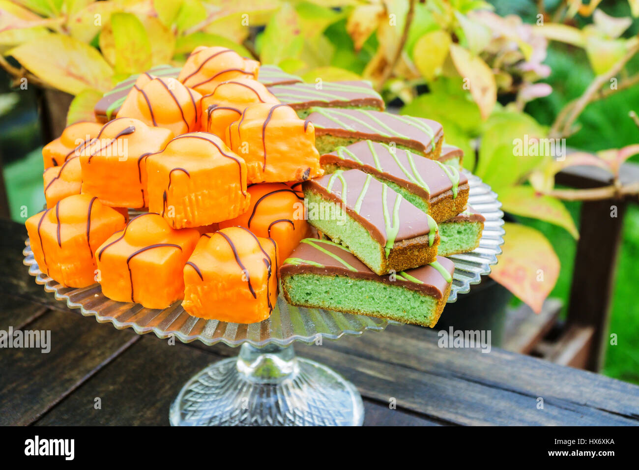 Cakes on a display stand outdoors - Stock Image