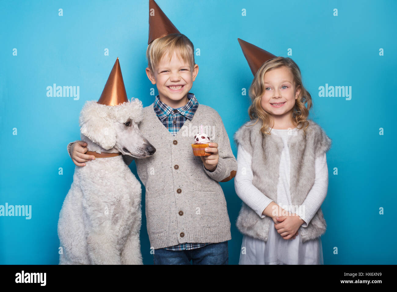 Little Beautiful Girl And Handsome Boy With Dog Celebrate Birthday Friendship Family Studio