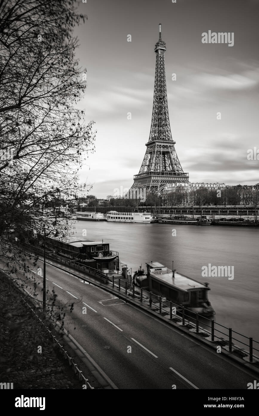 The Eiffel Tower and banks of the Seine River in Black & White. Paris, France - Stock Image