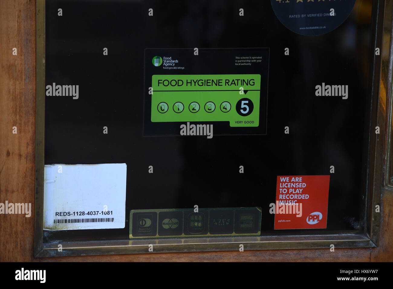 A Food Standards Agency Rating Sticker On A Window Of A