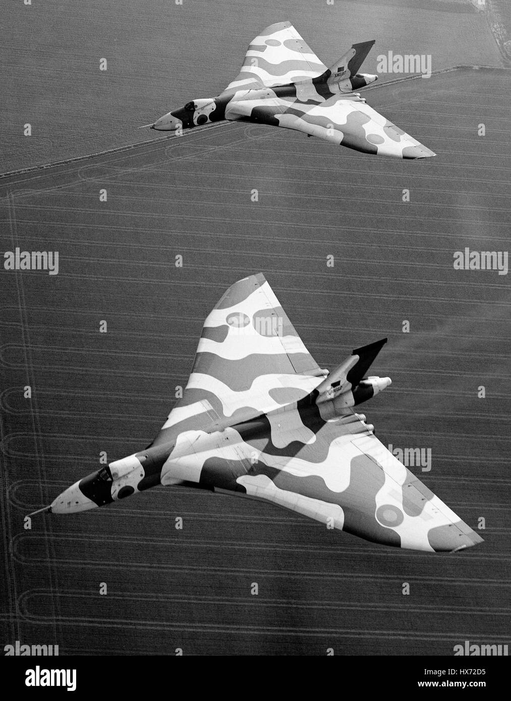 2 Avro Vulcan B2 bombers flying over the English countryside. - Stock Image