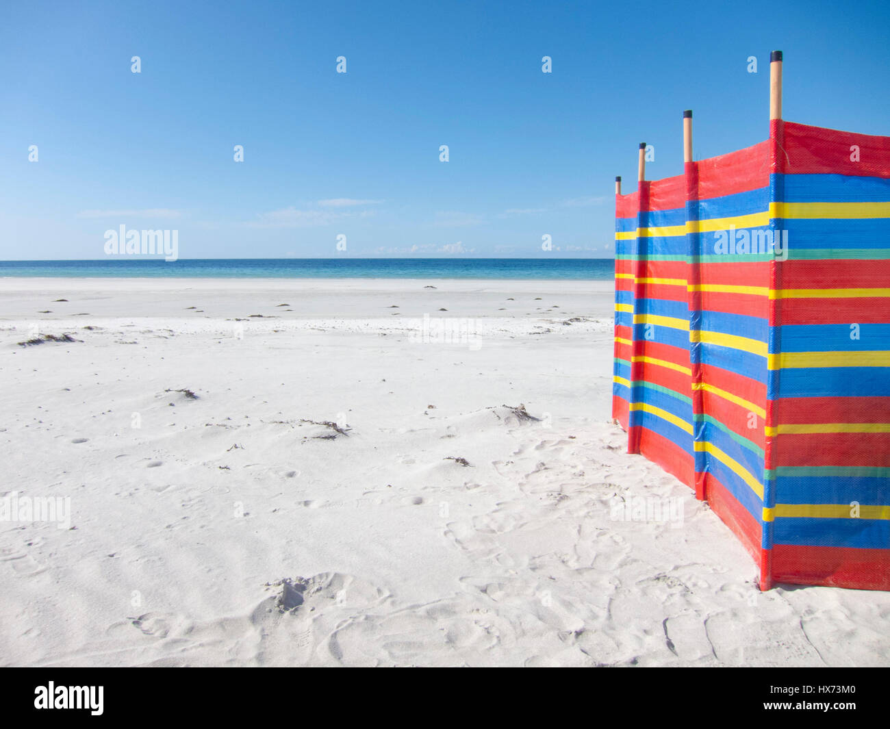 Wind break on an empty beach on South Uist, Outer Hebrides, Scotland, UK - Stock Image