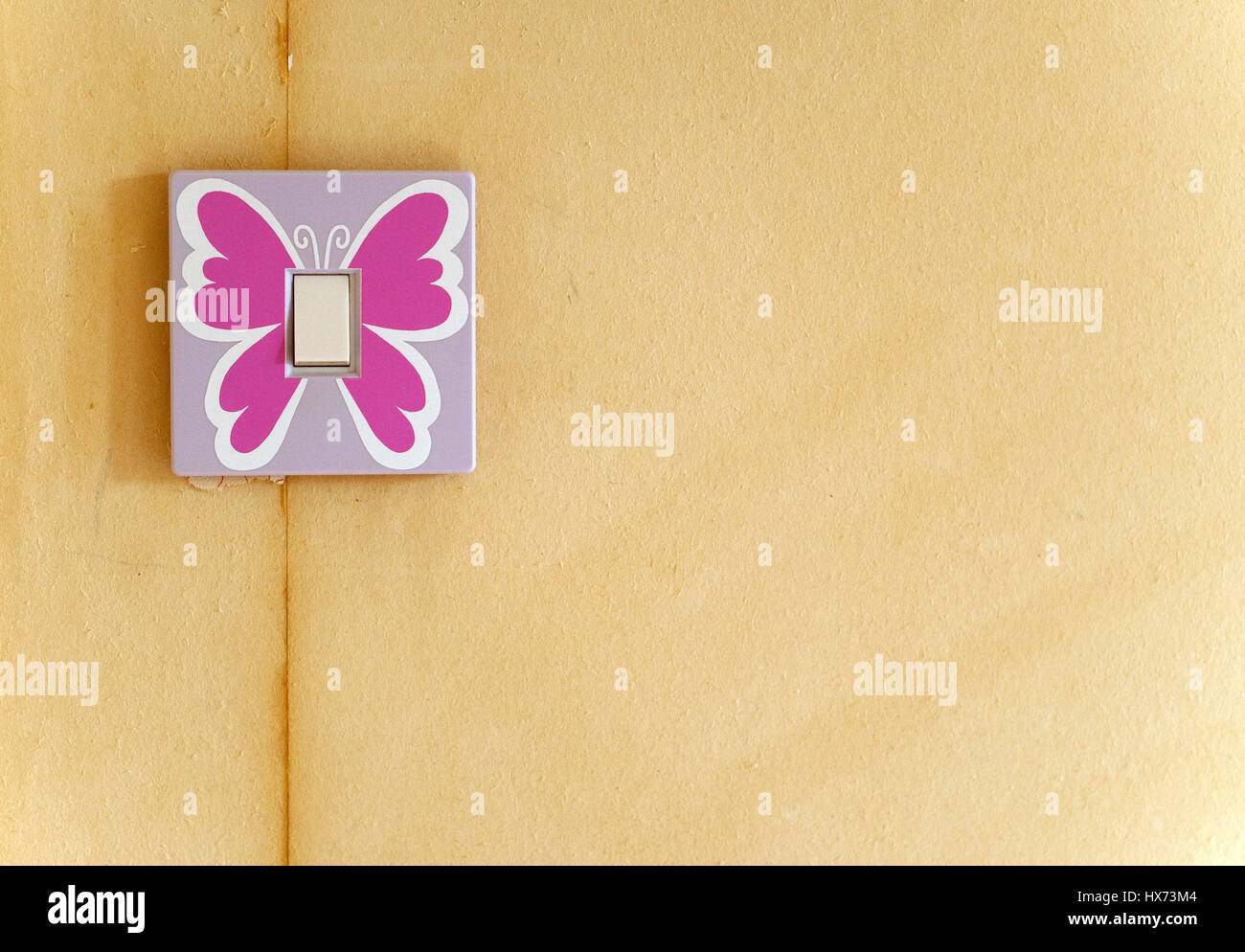 Decorating a childrens bedroom - Stock Image