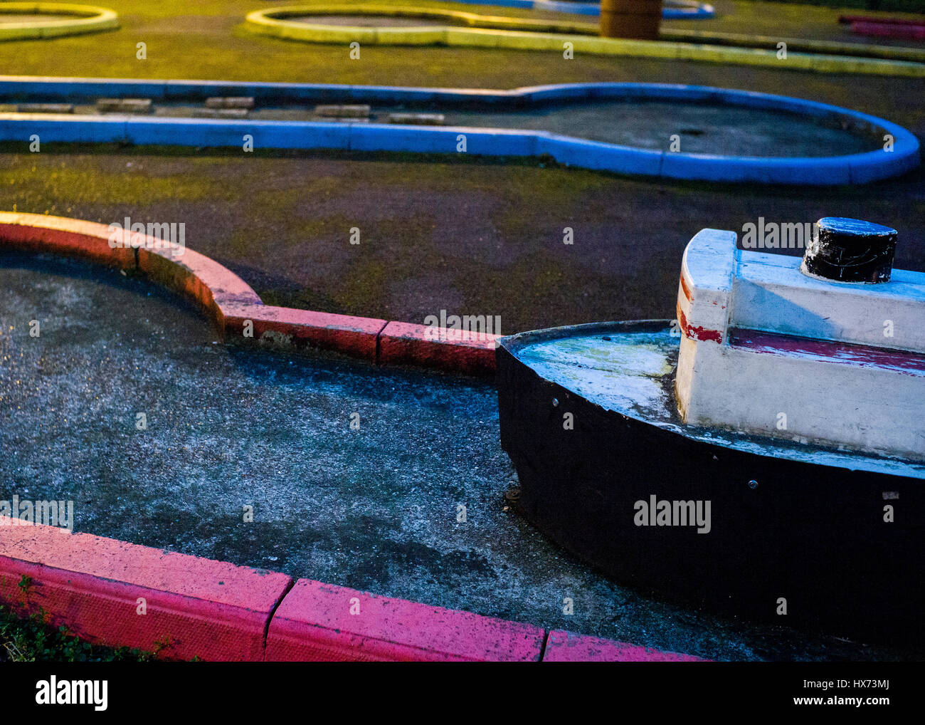 boat model in camden council estate crazy golf playground Stock Photo