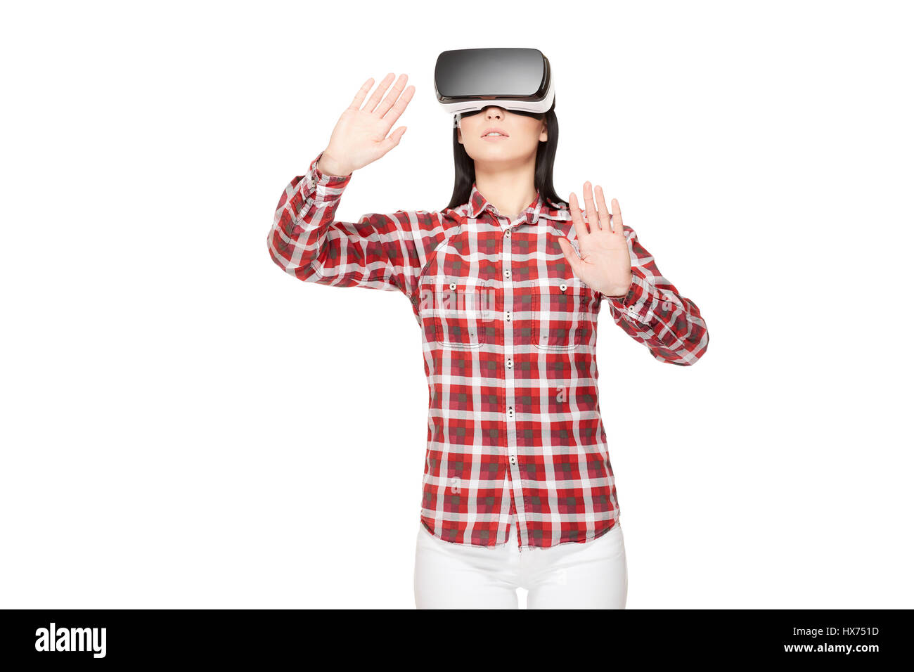 Young woman in VR headset traveling in cyberspace. - Stock Image