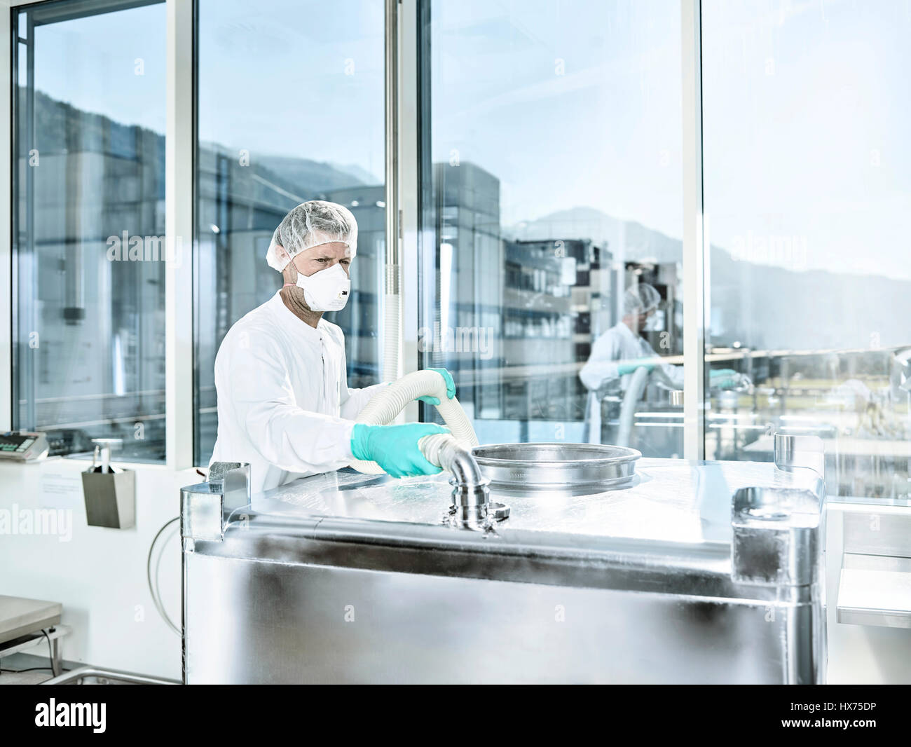Chemical Laboratory, Chemist with hairnet and face mask in a pharmaceutical production, Austria - Stock Image