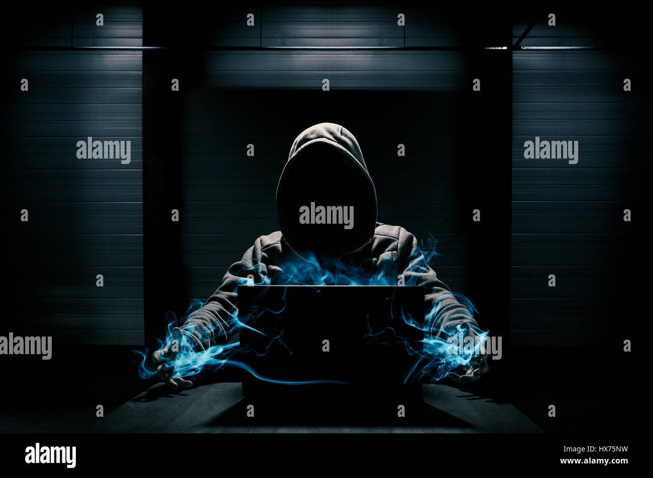 Abstract conception of hacker that takes control over laptop - Stock Image