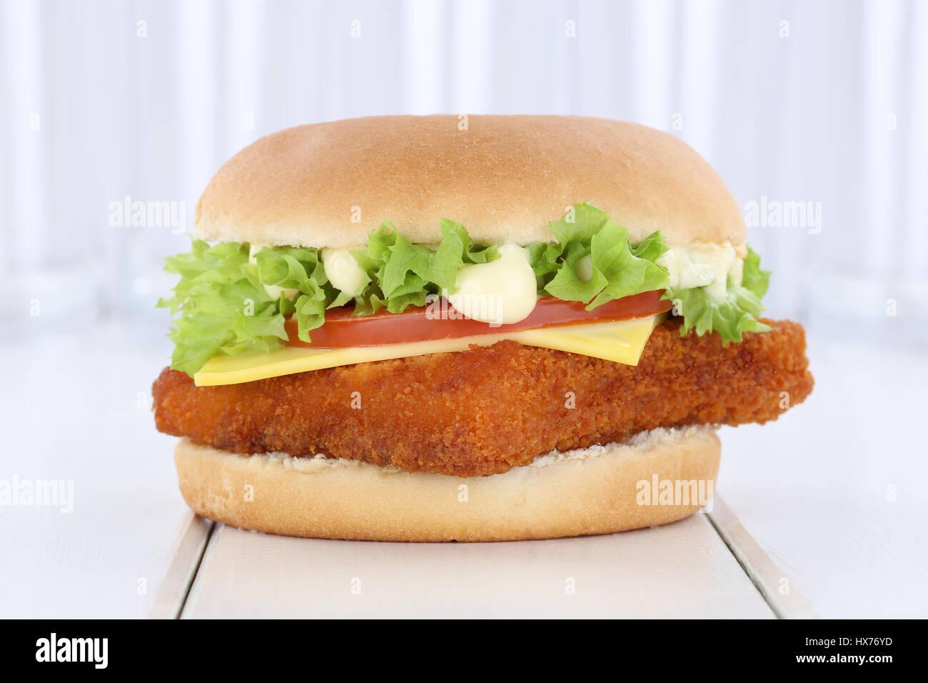 Fish burger fishburger hamburger fresh tomatoes lettuce cheese onion - Stock Image