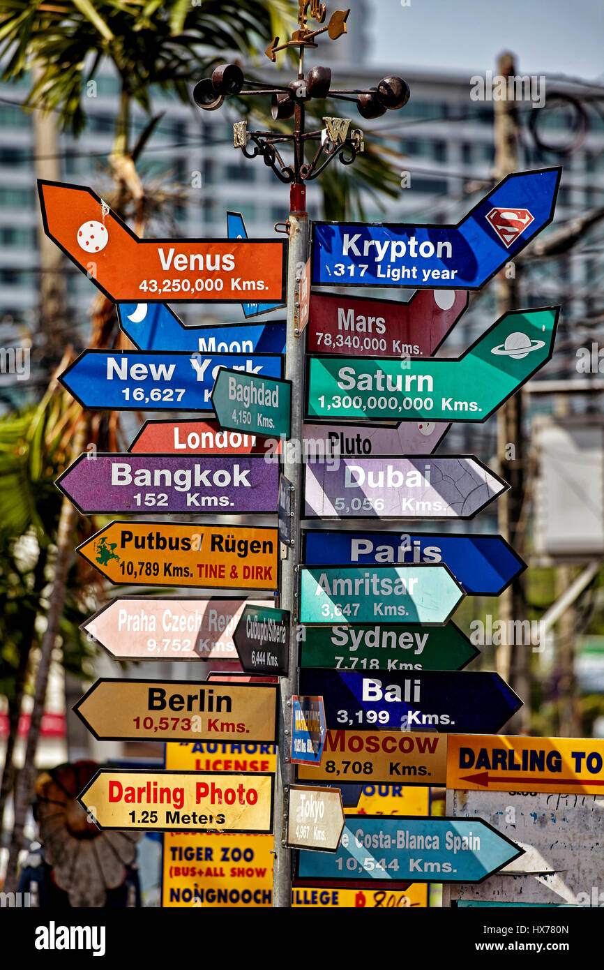 Amusing destination sign featuring both planet earth and outer space destinations. Thailand Southeast Asia - Stock Image